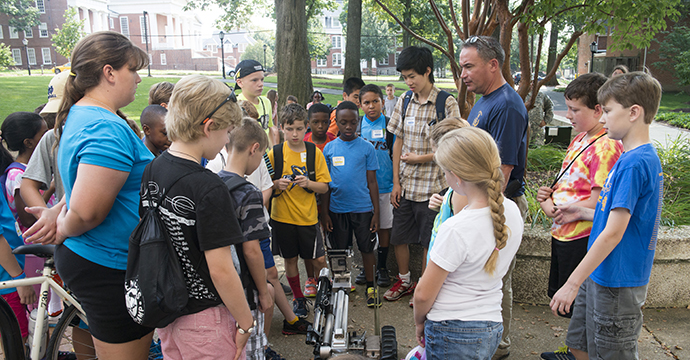 Students watch a bomb squad demonstration